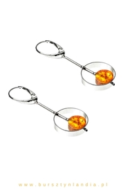 Original earrings with amber placed in a silver rim.